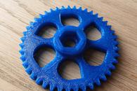 Carousel thumb gearwheel