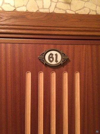 The plate with the number on the door