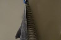 Carousel thumb towel hook in use