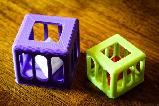 Caged Tetrahedron Puzzle