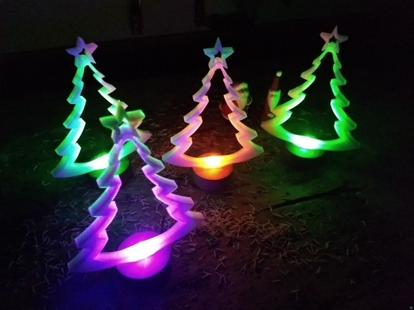 Christmas tree with wooden base and LED lightning