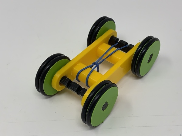Designing a Simple 3D Printed Rubber Band Car Using Autodesk Fusion 360