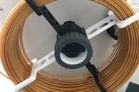 Carousel thumb filament holder