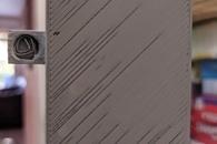 Carousel thumb latch paper clip