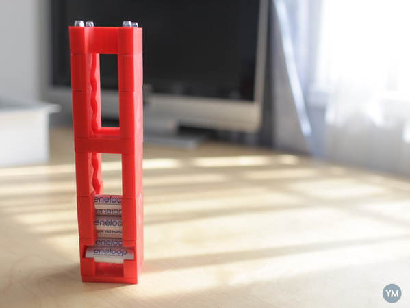 Modular FIFO AA battery holder